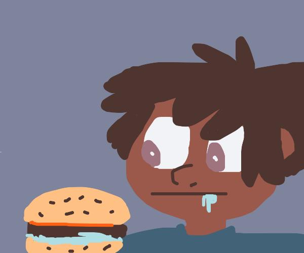 Man contemplates eating the borger