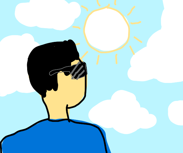 guy in sun glasses looking at the sky