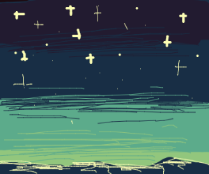 ocean at night with star filled sky