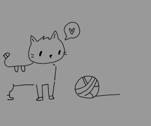 Kitten plays with ball of yarn
