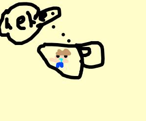 boy hiding in an ominous tea cup