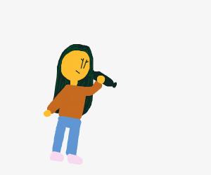 Girl holding black sausage