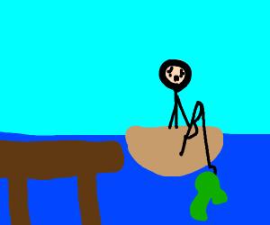 Sad fisherman just caught a seaweed