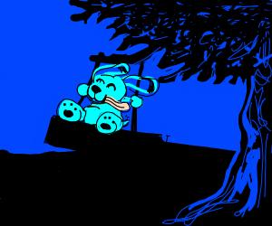 Cute pupper swings on a tree mounted swing