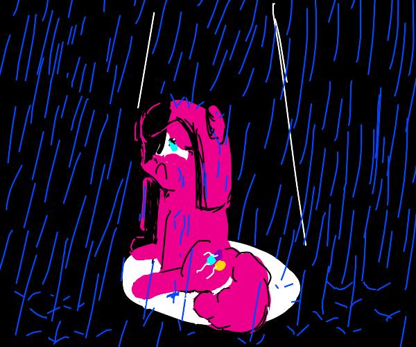 Sad pony on a rainy say