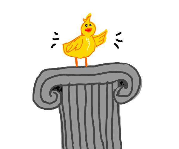 Chick on a pedestal