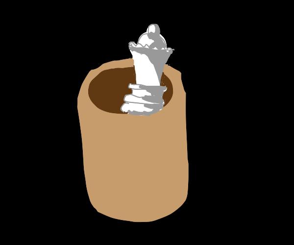 a handless mug with a quen chess piece inside