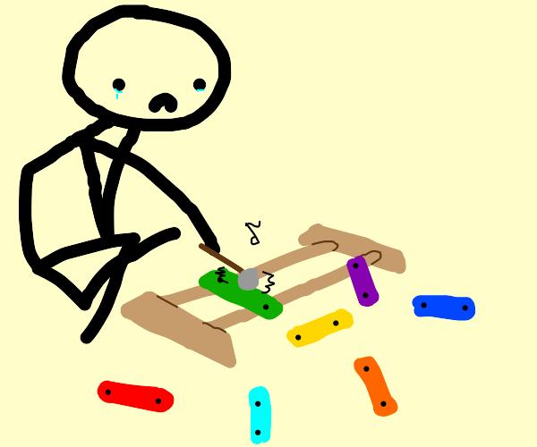 guy plays singular xylophone plate.