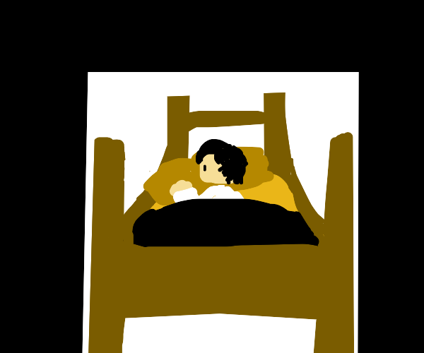 person lying in a bed