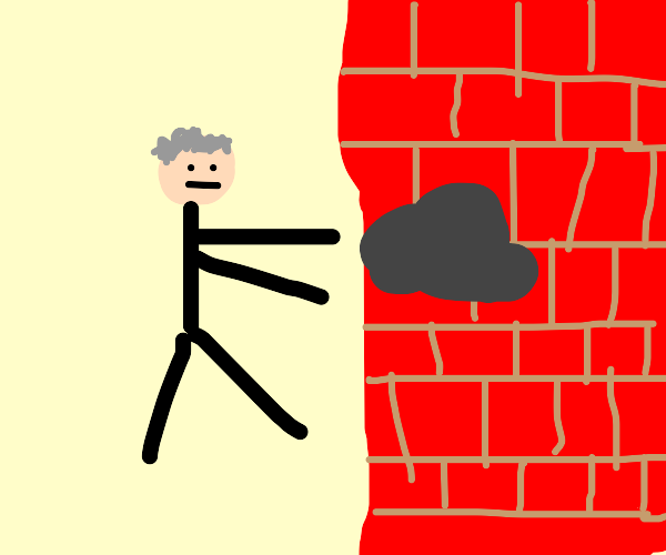 Grey haired man reaches for lump on the wall