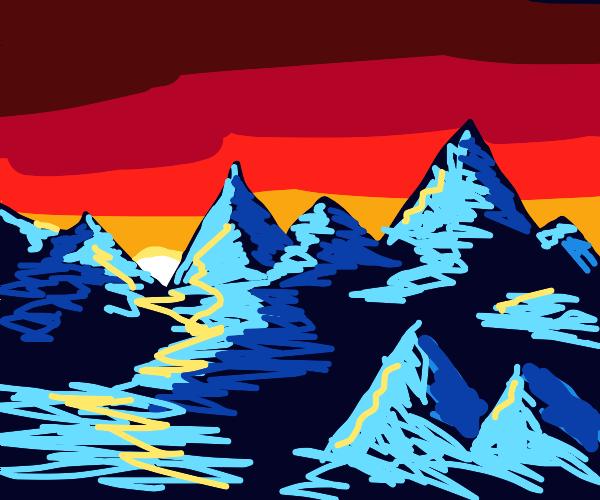 The sun rises far beyond the blue mountains