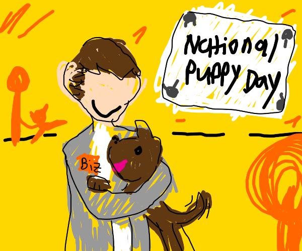 businessman holding a puppy