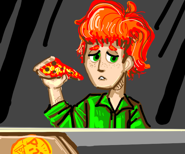 Ginger lad eating pizza alone