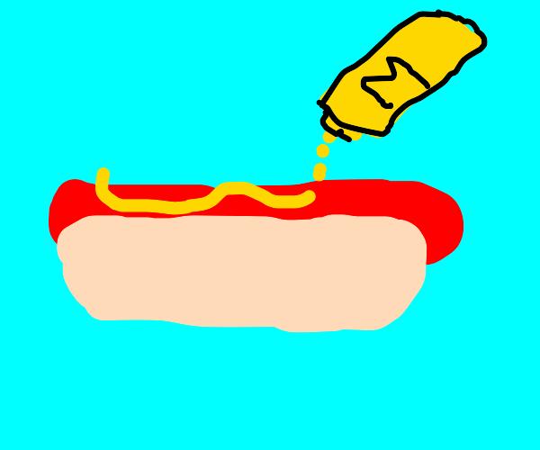 squirtin mustard on a hot dog