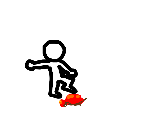 boy steps on red balloon