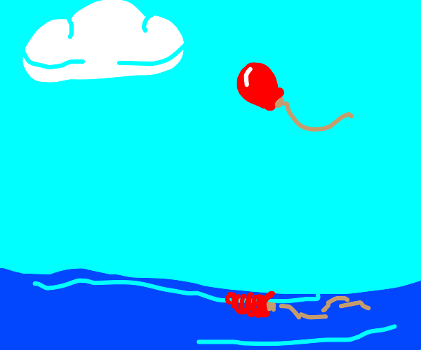 Red balloon coming into horizon over sea