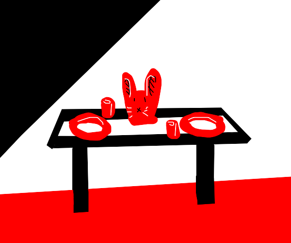 a rabbit head on the dinner table