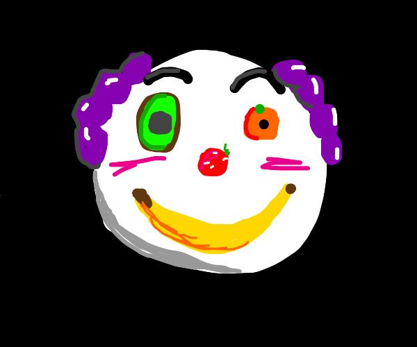 Clown face made of fruit.