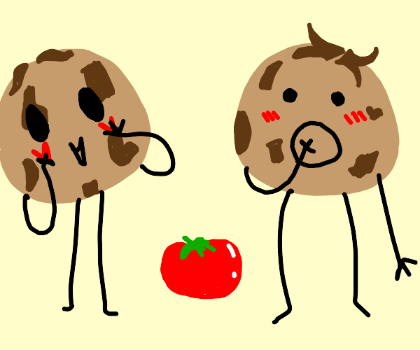 Two chocolate chip cookie people and a tomato