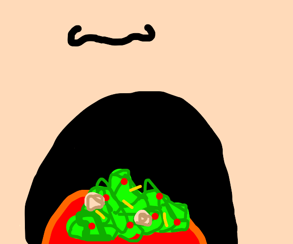 closeup on a mouth full of salad.