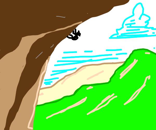 man trying to rock climb