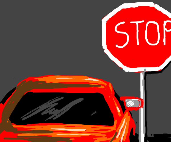 driving a red car towards a stop sign