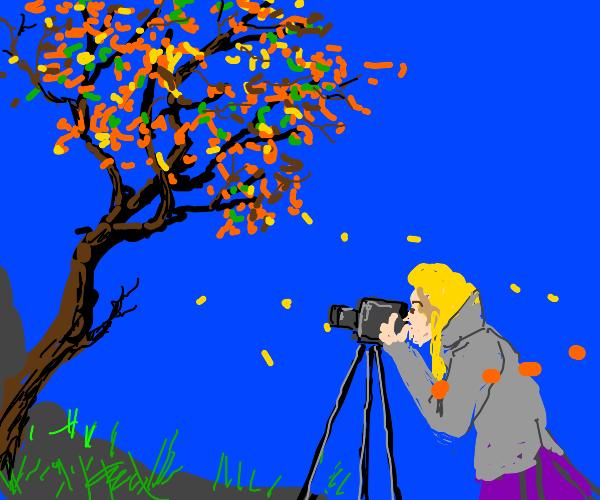 windblown leaves around lady photographer