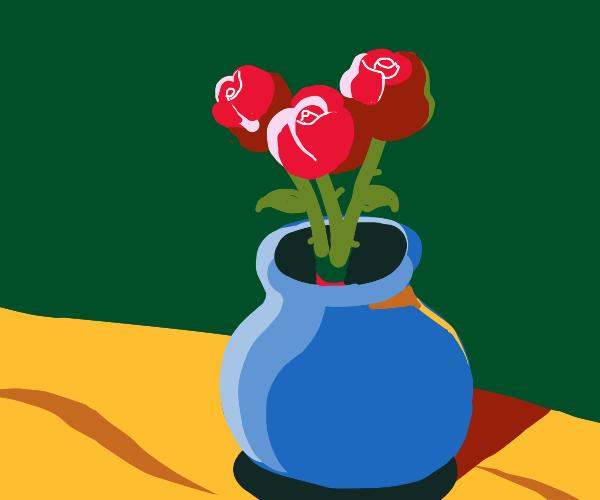 Red roses in a blue vase