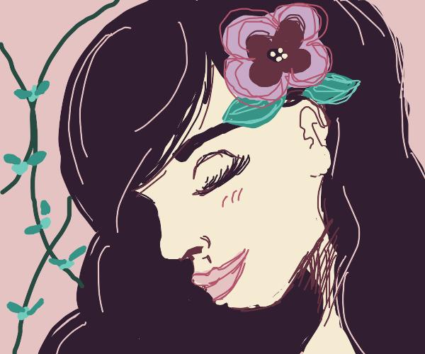 Girl whit a flower in hair.