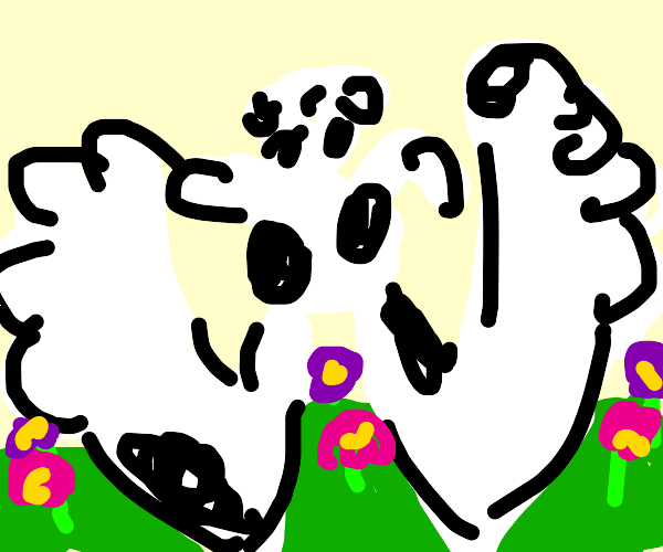 a cow playing in a flower field