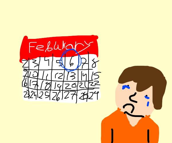 depressed guy looks at calendar on Feb 06