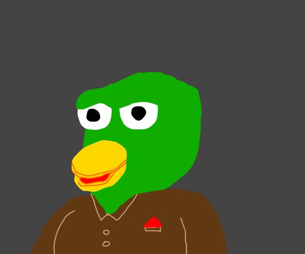 a green duck wearing a brown shirt