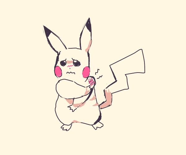 Pikachu caresses her sore shoulder
