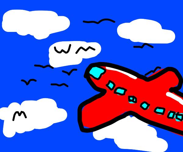 red plane flies amongst birds