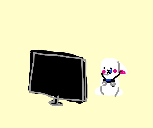 Depressed rabbit plays video games