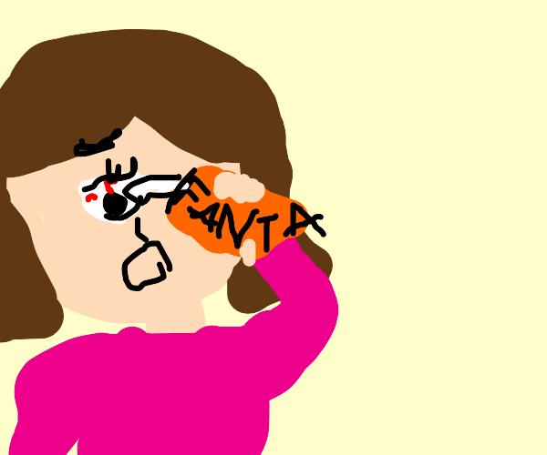 Girl squirting Fanta in her eye