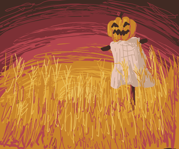 Scarecrow made with a pumpkin and a sheet