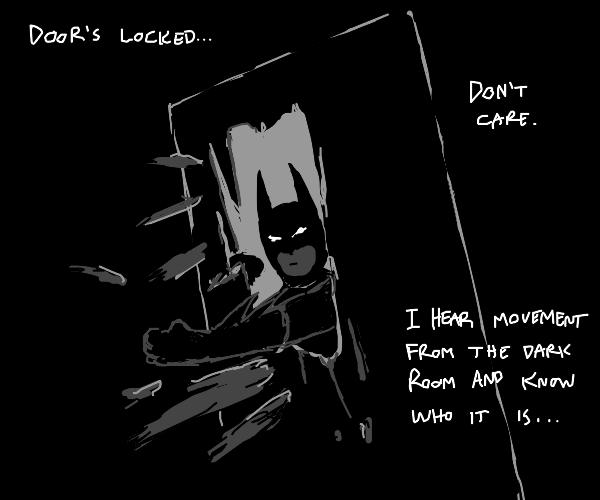 Batman punches a door
