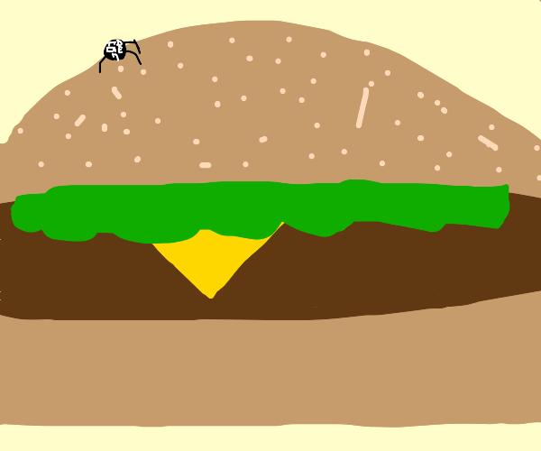 Toddler sneaking up on hamburger