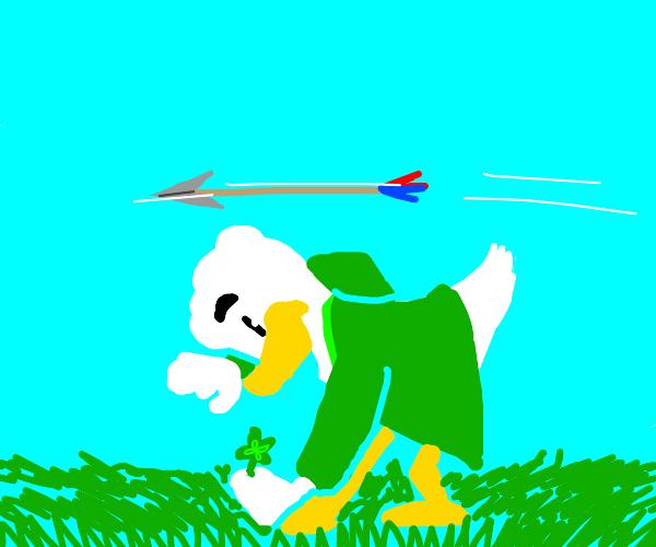 man dodges arrow by picking  four leaf clover