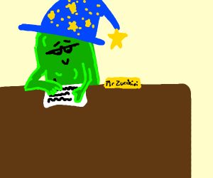 wizard zucchini works at his desk