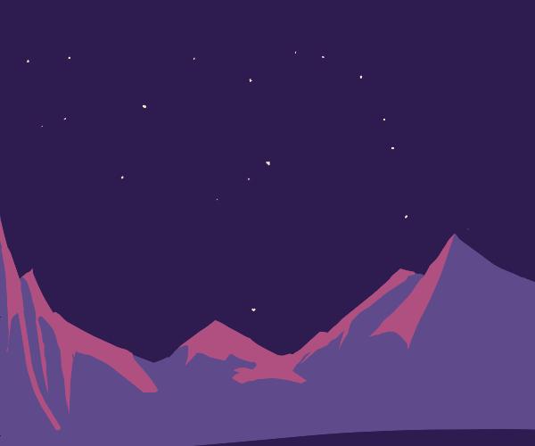 Constellations over desert mountains