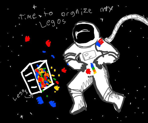 nasa astronaut organizing his LEGO pieces.