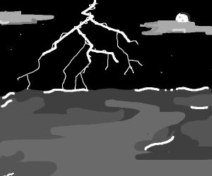 Lightning strikes above the ocean