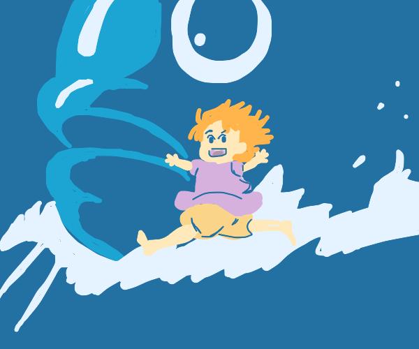 Child gliding on fish