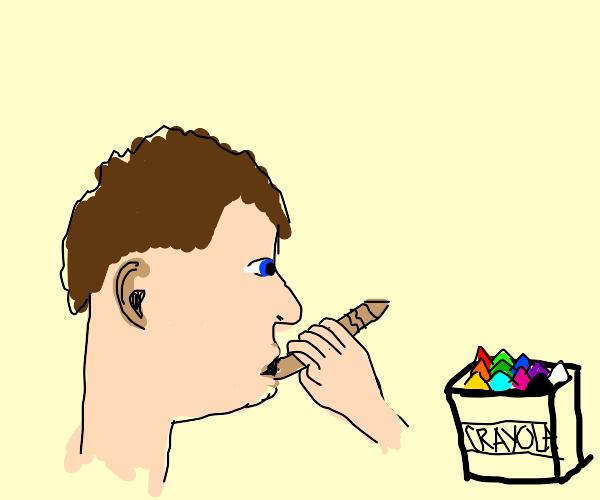 Man eating a beige crayon