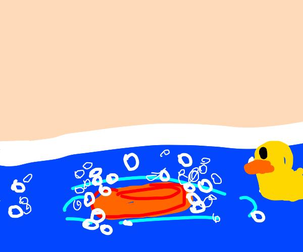orange bar of soap floating in water