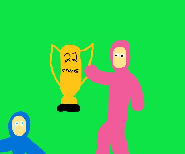 pink guy wins 22 stunts trophy over blue guy