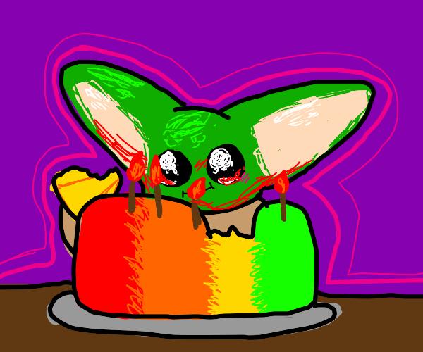 baby yoda eating rainbow cake