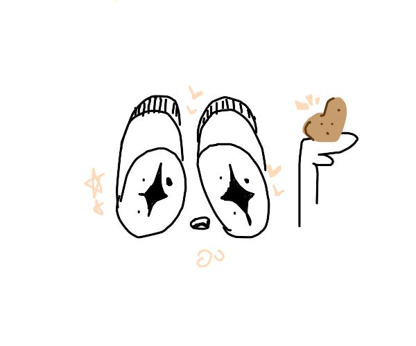 Starry-eyed man admires his potato